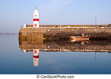 Old Lighouse and Boat with Sea Water Replection