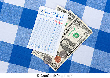 Meal check with change - A meal check from a restaurant with...