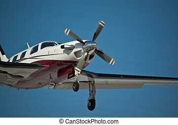 Light Aircraft in Flight - A small single-engined aircraft...
