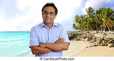 Indian latin tourist man portrait tropical caribbean beach