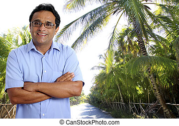 Indian latin tourist man in tropical palm tree caribbean