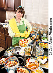 Woman doing the dishes - A smiling homemaker gets ready to...