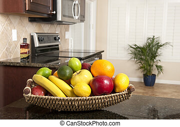 Basket of fresh fruit in modern kitchen