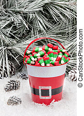 Decorative pail of Christmas candy - A decorative pail of...