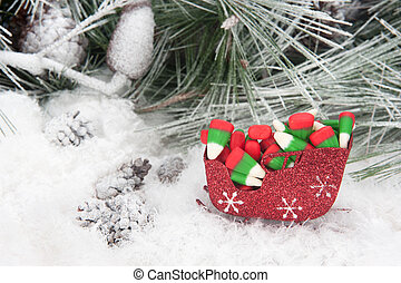 Christmas candy in sleigh - Studio shot setting of a...