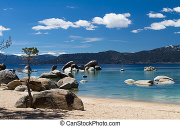 Lake Tahoe  beach with few clouds on the sky