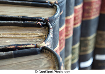 Closeup on Old Legal Law Books - Closeup on top of old legal...