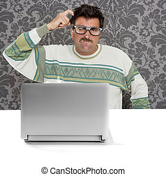 Nerd pensive man glasses silly expression laptop computer...