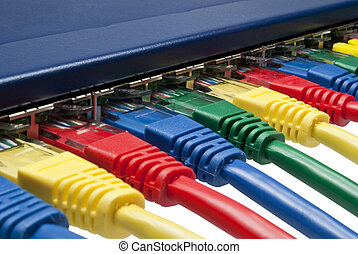 Multi color ethernet network plugs connected to a router /...