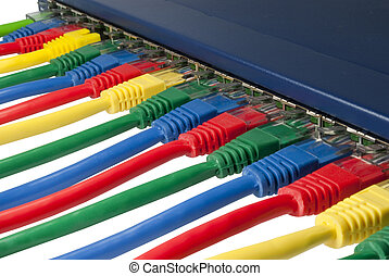 Multi colored ethernet network cables connected to a router...