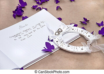 Opened Wedding Guest Book with a Good Luck Horseshoe and...