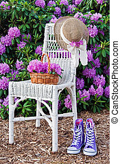 Rhododendron Garden - Wicker chair with sneakers and wicker...
