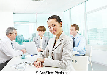 Pretty office worker - Portrait of smart employer looking at...