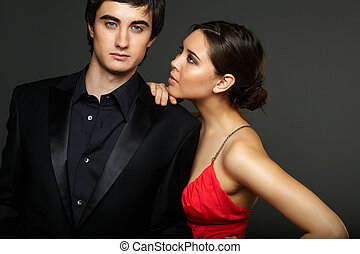 Luxurious couple - Portrait of handsome man looking at...