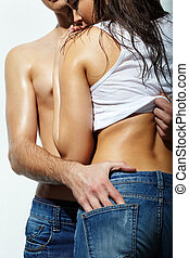 Love - Close-up of couple in jeans posing in studio