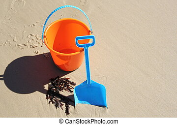summer - bucket and spade on beach