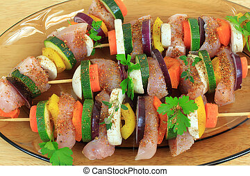 Grill skewer shashliks preparation - delicious meat cuisine with zucchini, onions, carrots and peppers