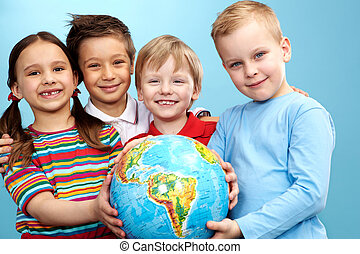 Children with globe - Group of adorable boys and girl with...