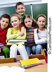 Classmates in school - Portrait of happy children looking at...