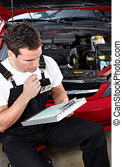 Auto mechanic - Handsome mechanic working in auto repair...
