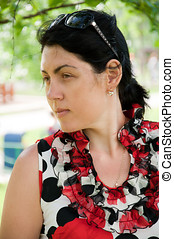 Beautiful middle-aged woman in a park