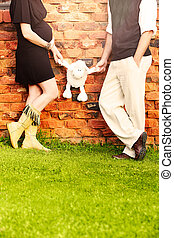 pregnant couple - Expecting couple with eight months...
