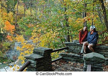 Hiking Break in Letchworth - A couple takes a break from...
