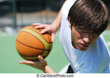 Basketball Player - Boy playing basketball - Ball blurred...
