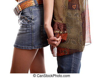 Handclasp of two girl friends on white background