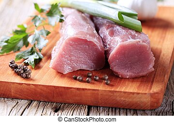Raw pork tenderloin - Raw tenderloin of pork on a cutting...