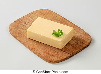 Fresh butter - Block of fresh butter on a cutting board