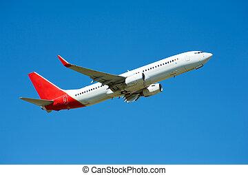 plane - Large passenger plane flying in the blue sky