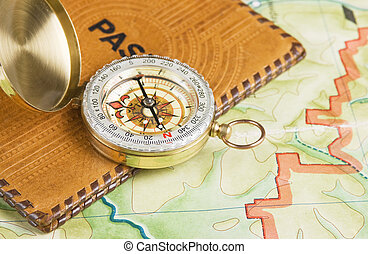 compass and passport on the map