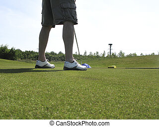 Golfer standing on green