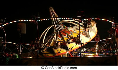 Amusement park ride - Colorful illuminated fun ride in...