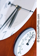 Clock and thermometer.