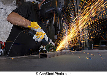 metal grinding - sparks flying over the working table during...