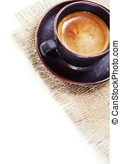 coffee cup on burlap with copyspace