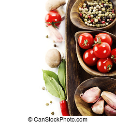 fresh vegetables and spices over white with copyspace