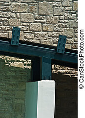 Architectural detail - Steel bridge over stone wall