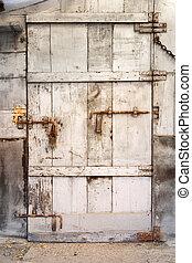 okd wooden door - door of wooden plank with bolts of old...