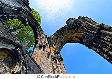 Archway ruins - Ancient arches of a monastery against a blue...