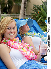 Good Times - Two young women on vacation relaxing and having...