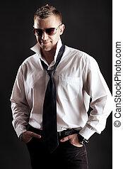tie - Portrait of a handsome man in a suit. Studio shot.