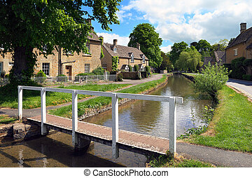 Cotswolds village of Lower Slaughter in early summer -...