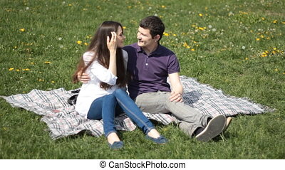 man and woman in the park - young people in the park on...