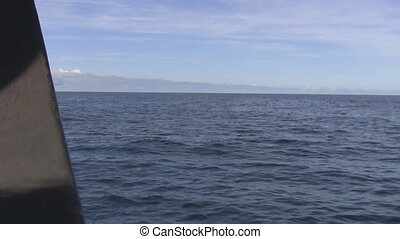 Sea view from a sailing ship - Deep ocean, blue sky and...