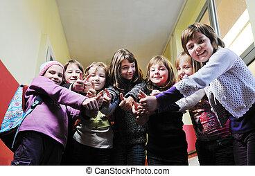 happy children group in school - happy school girls running...
