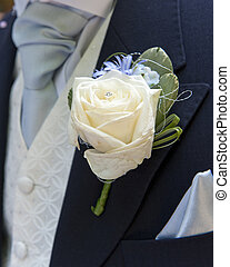 Grooms buttonhole - Close up of a grooms buttonhole