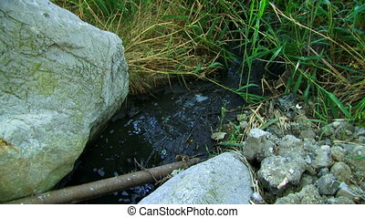 Unknown pollution - From an old rusty pipe follows an...
